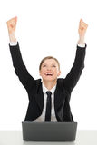 Happy businesswomen with laptop, hands up. On white background Royalty Free Stock Images