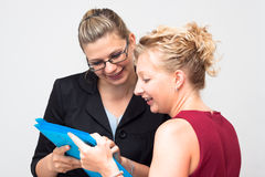 Happy businesswomen looking at document Royalty Free Stock Photos