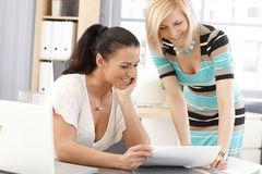 Happy businesswomen sharing success at office Stock Images