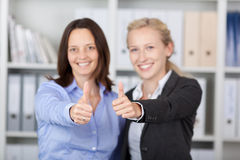 Happy Businesswomen Showing Thumbs Up Sign Stock Images