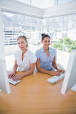 Happy businesswomen working side by side Royalty Free Stock Images