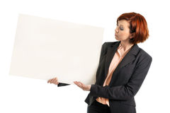 Happy busy business woman holding  blank cardboard sign copy space Stock Images