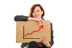 Happy busy business woman holding growth sales graph. Happy successful red hair business woman wearing a suit holding growth sales graph on a white background Stock Images