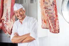 Happy Butcher With Arms Crossed In Slaughterhouse Stock Images