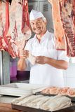 Happy Butcher Holding Chicken Meat In Butchery Royalty Free Stock Photo