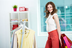 Happy buyer. Portrait of pretty woman with colorful bags in clothing departmant Royalty Free Stock Photo