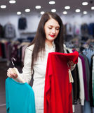 Happy buyer at fashionable shop Royalty Free Stock Photo