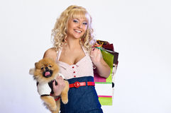 Happy buyer. Young happy beautiful  woman go to shopping Royalty Free Stock Images