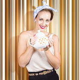 Happy cafe waitress holding hot coffee kettle Stock Image