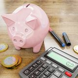 Happy calculator and piggy bank Royalty Free Stock Image
