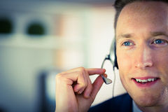Happy call center agent working. In his office Stock Photo