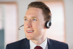 Happy call center agent working. In his office Royalty Free Stock Photo