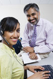 Happy Call Center Employees Working Together Stock Image