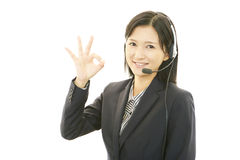 Happy call center operator making ok sign Royalty Free Stock Photography