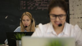 Happy call center operators. Call center operators,two women talking on the phone stock video