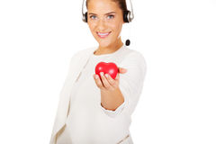 Happy call center woman with heart toy Stock Photo