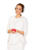 Happy call center woman with heart toy Stock Images