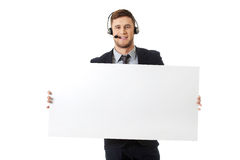 Happy call center woman holding empty banner. Royalty Free Stock Photo