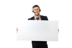 Happy call center woman holding empty banner. Royalty Free Stock Photography