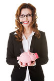 Happy call center woman with piggy bank. Royalty Free Stock Image