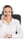 Happy call center woman sitting at the desk Stock Photo