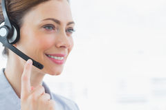 Happy call centre agent smiling. Wearing headset Royalty Free Stock Image