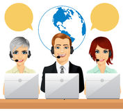 Happy call centre agents talking on headsets using laptops Royalty Free Stock Image