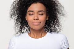 Happy calm african woman taking deep breath of fresh air stock photo