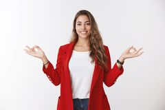 Happy calm stress-free modern 25s businesswoman control feelings hands sideways showing mudra zen gesture smiling royalty free stock photo