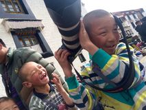Happy with the camera. Tibetan children happy with the camera Stock Image