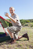 Happy camper setting up his tent Royalty Free Stock Photography