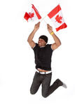 Happy Canada Day. Patriotic happy Canadian man waiving flags on July 1st Canada Day stock image