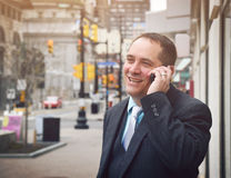 Happy Candid Business Man Talking on Cell Phone Stock Photography
