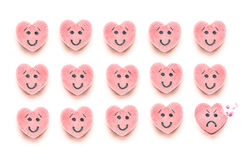Happy Candy Hearts in Rows with One Bitten Sad Candy Royalty Free Stock Images