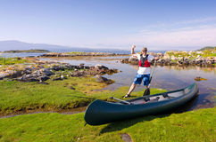 Happy canoe angler in wild nature Stock Image