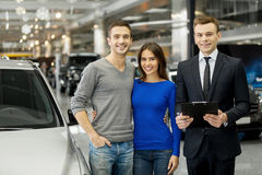 Happy car owners. Royalty Free Stock Photo