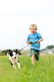 Happy carefree boy running Royalty Free Stock Photo