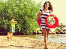 Happy carefree family walking on beach at sea. Happy carefree family little kid and mother walking on beach at sea coast. Summer holidays vacation. Happiness royalty free stock photo