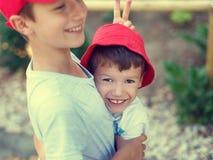 Happy carefree little boy showing donkey ear Stock Photo