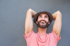 Happy carefree man laughing with hat Stock Photography