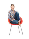 Happy and carefree teenage girl in chair Stock Photo