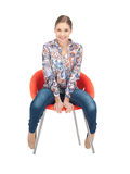 Happy and carefree teenage girl in chair Stock Images