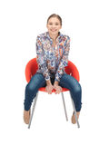 Happy and carefree teenage girl in chair Stock Photos
