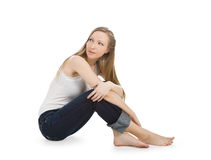 Happy and carefree teenage girl sitting on the Royalty Free Stock Photography