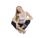 Happy and carefree teenage girl sitting on the Royalty Free Stock Photo