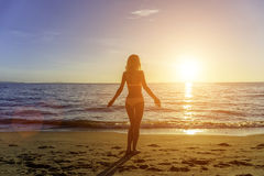 Happy Carefree Woman on the Beach Stock Photography