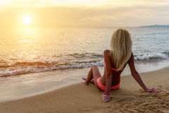 Happy Carefree Woman on the Beach Stock Photo