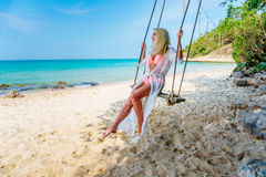 Happy Carefree Woman on the Beach Stock Images