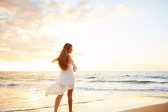 Happy Carefree Woman on the Beach at Sunset Royalty Free Stock Photos