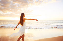 Happy Carefree Woman on the Beach at Sunset. Happy Carefree Woman Enjoying Beautiful Sunset on the Beach stock photography